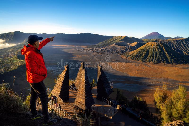 Asian traveller stand at top of Seruni view point for see sunrise at Bromo mountain. National park, Java island, Indonesia royalty free stock photos