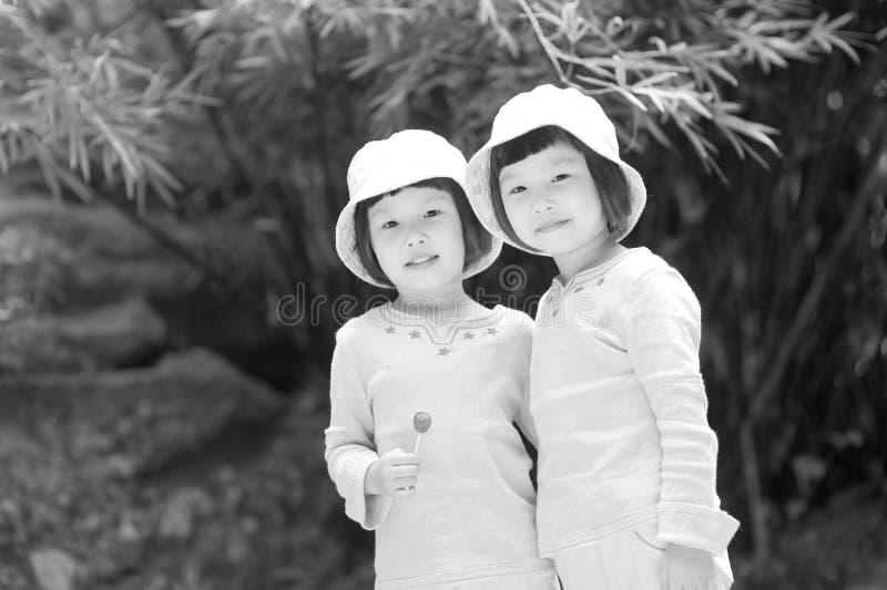 Asian twin little girls stock photo