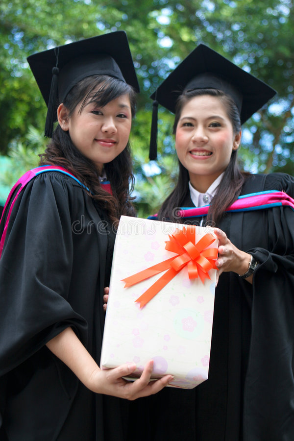 Asian university graduates stock images