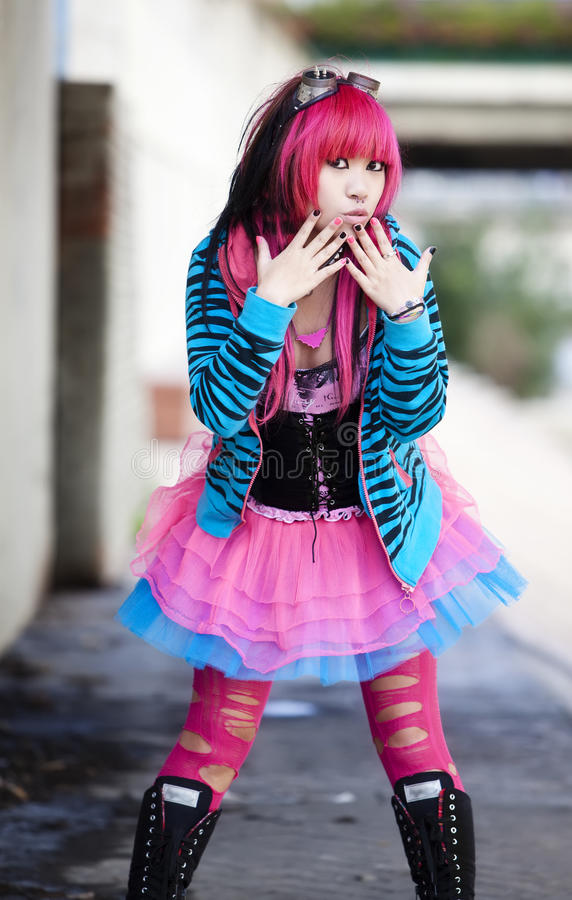 Asian urban lolita. Young asian girl in oops gesture stock image