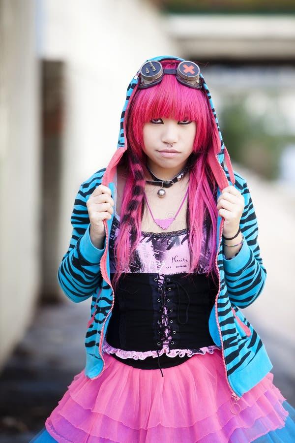 Asian urban lolita. Young asian girl staring at camera royalty free stock photos
