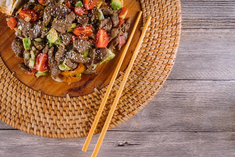 Asian, vietnam or thai cuisine. Beef with vegetable. On wood plate, food, meal, meat, lunch, dinner, dish, traditional, hot, green, delicious, red, spicy stock photo