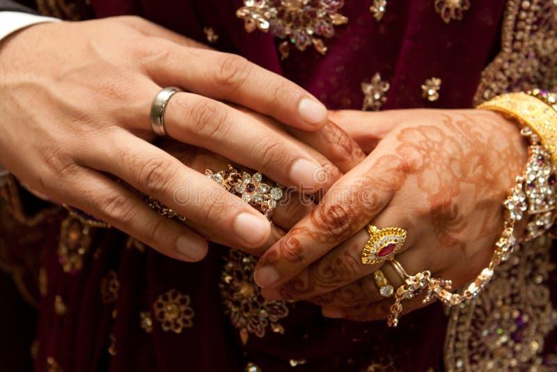 Asian wedding. Close up of an asian wedding couple's hands stock photo