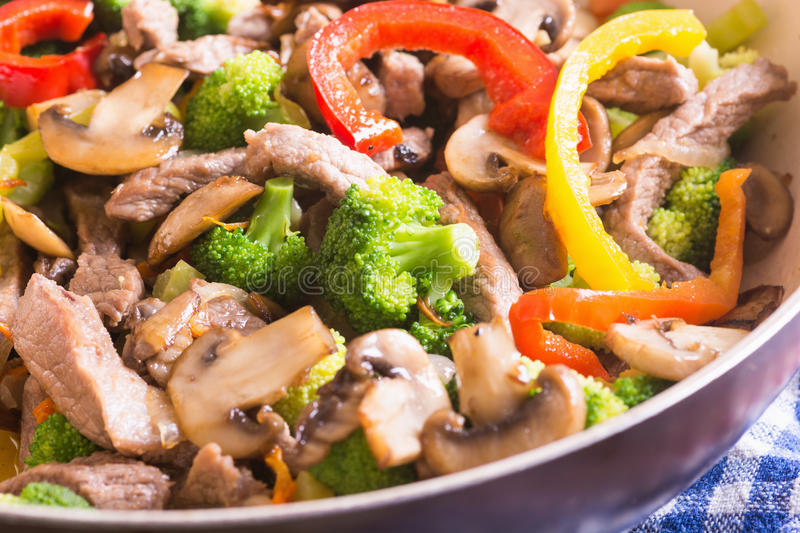Asian wok. With beef and vegetable stir fry royalty free stock photography