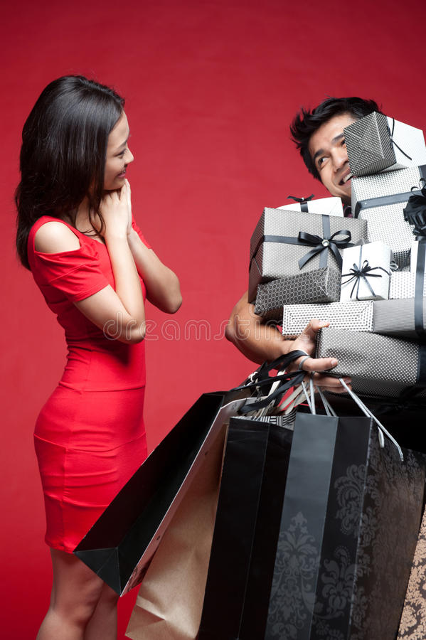 Asian Woman accepting presents from a young man