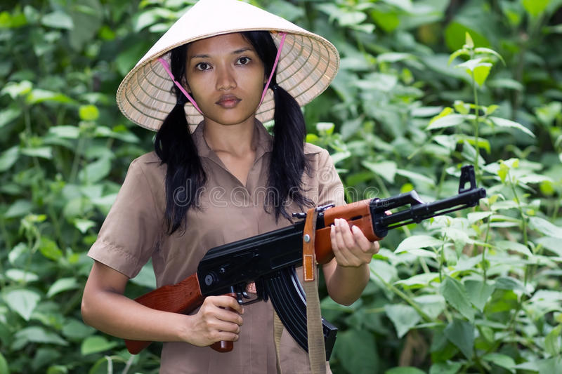 Download Asian woman armed stock image. Image of automatic, battle - 29055923