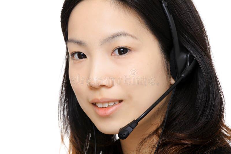 Asian woman assistant wearing headset. Close up stock photos