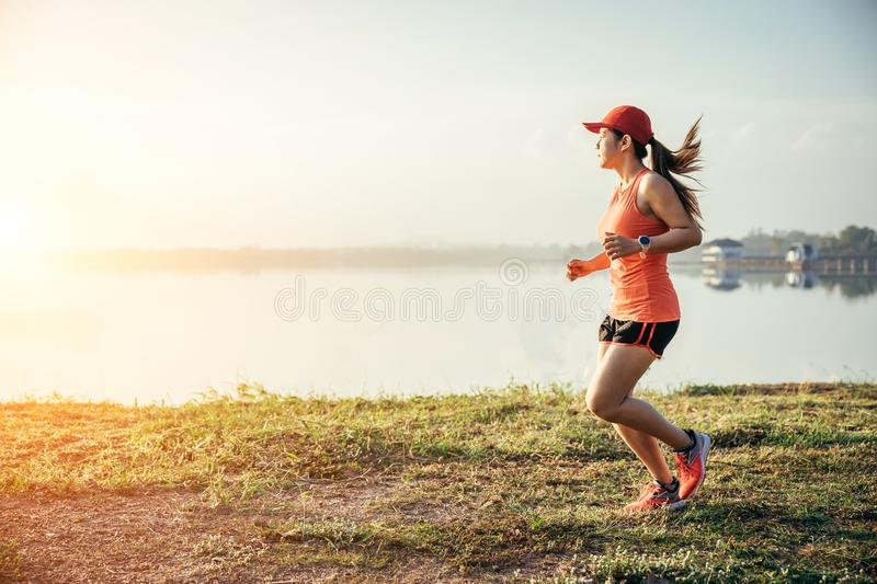 An asian woman athletic is jogging royalty free stock photos