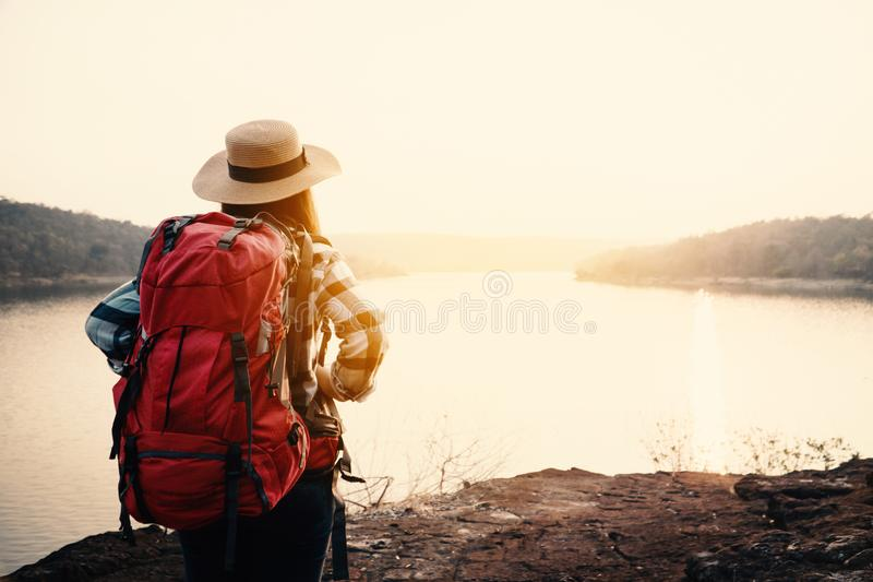Asian woman backpack on the park journey and traveling on holiday stock images