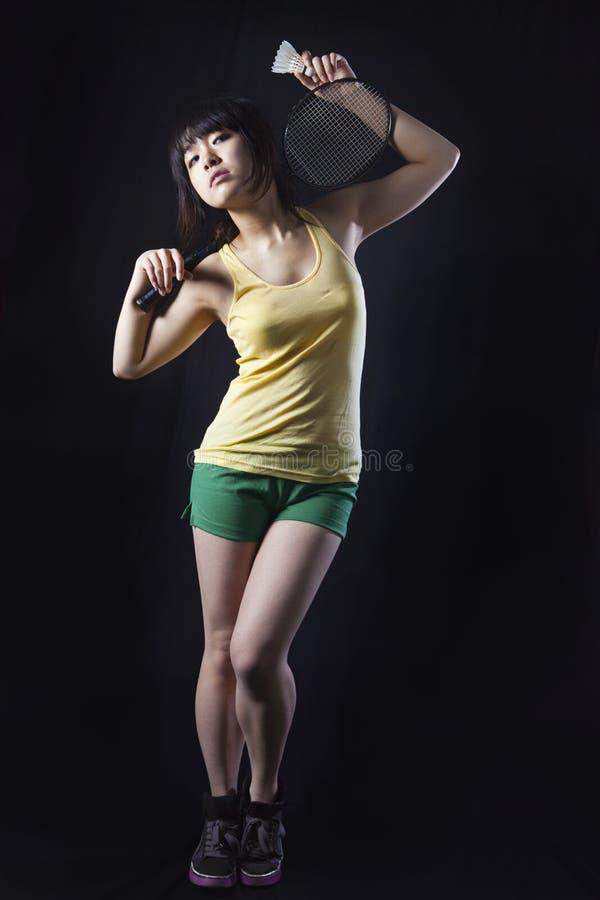 Asian Woman With Badminton Racket Stock Photos
