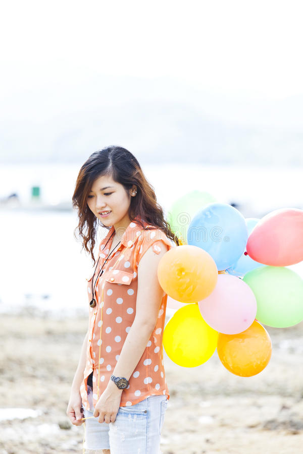 Asian woman with balloon stock photo
