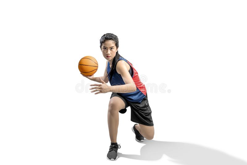 Asian woman basketball player in action with the ball royalty free stock image