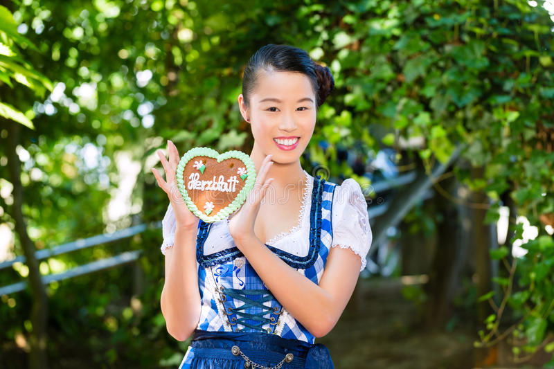 Asian Woman With Bavarian Gingerbread Heart Stock Image