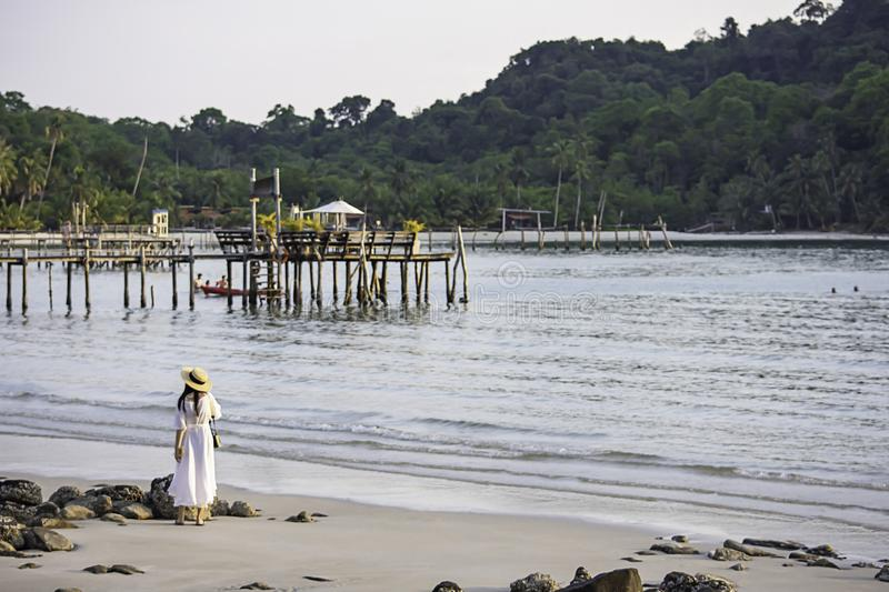Asian woman on the beach the background sea and a wooden bridge at Koh Kood, Trat in Thailand stock photos