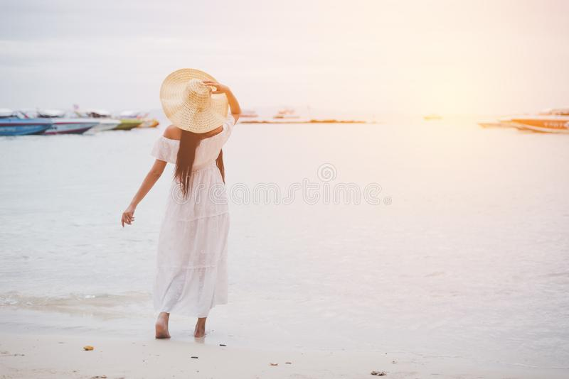 Asian woman on beach enjoying travel and fresh air in holidays. Vacation and Outdoors concept. People and Nature concept. Asian beauty and Sea theme royalty free stock photos