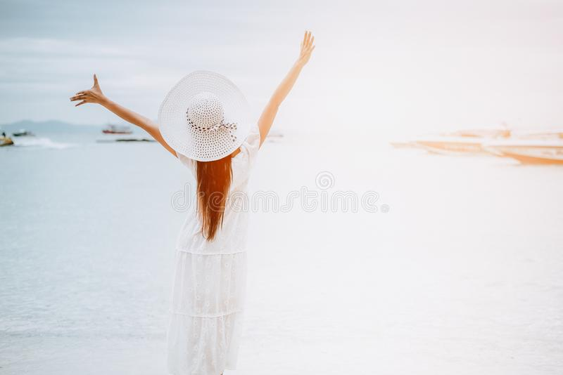 Asian woman on beach enjoying travel and fresh air in holidays. Vacation and Outdoors concept. People and Nature concept. Asian beauty and Sea theme stock photography