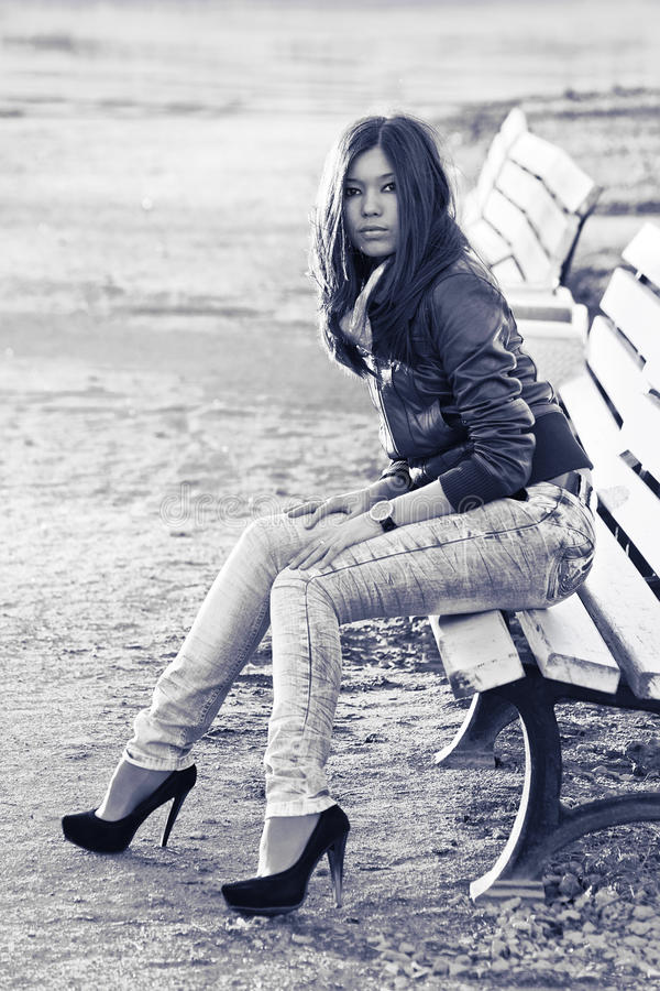 Download Asian Woman On Bench Royalty Free Stock Photo - Image: 14155915