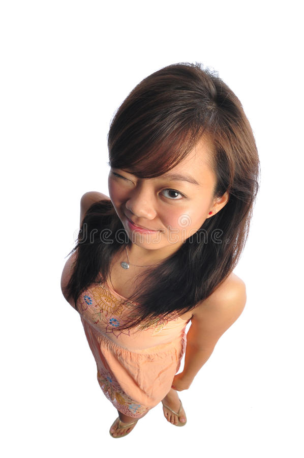 Asian Woman With Big Doll Head. Beautiful young Asian Woman picture taken from the top to give a big doll head effect stock image