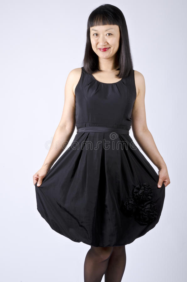 Download Asian Woman In Black Party Dress Stock Image - Image: 20042369