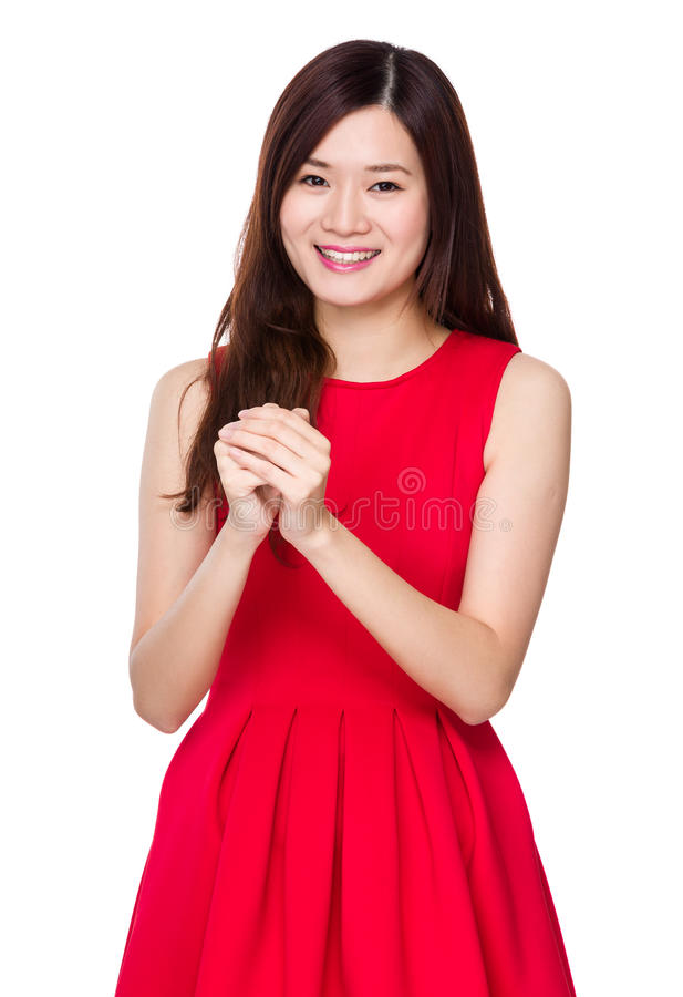 Asian woman with blessing sign for Chinese new year royalty free stock image