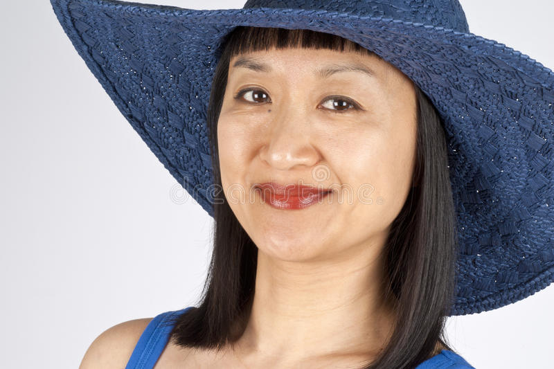 Asian Woman In Blue Straw Hat Stock Photo