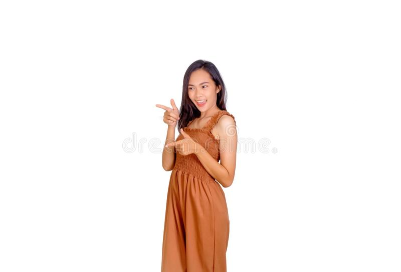 An Asian woman in brown tank top points her finger to the empty space stock photos