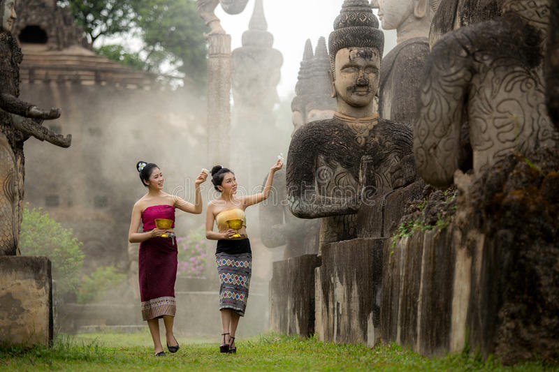 Asian woman Buddha statue water ceremony in songkran festival, laos stock images