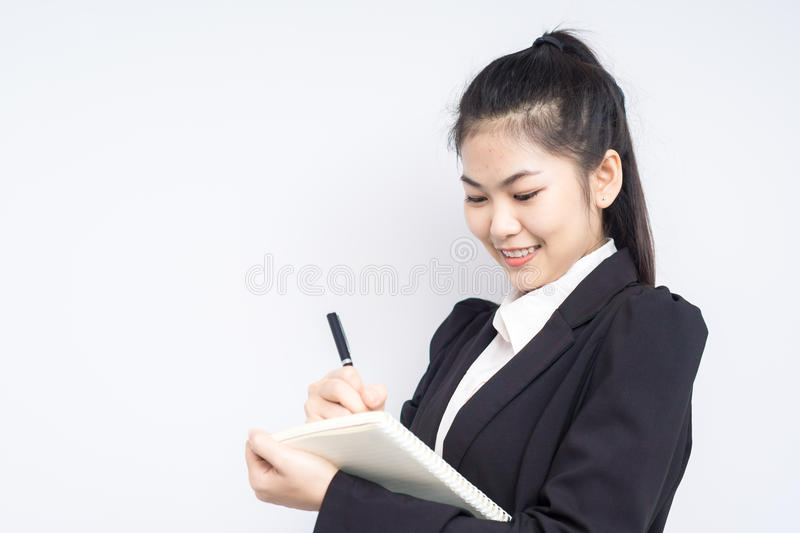 Asian woman in business black dress suit holding an office notebook. stock photo