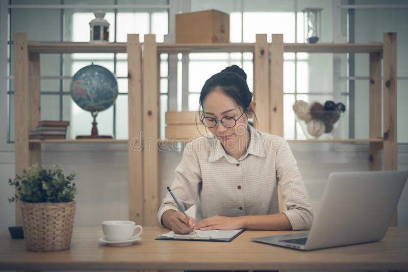 Asian woman business owner work at home.  royalty free stock photography