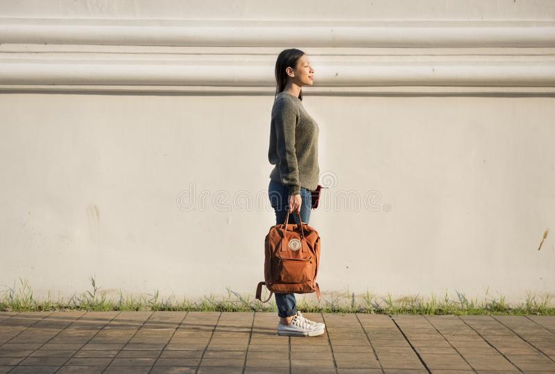 Asian woman carrying a bag stock image