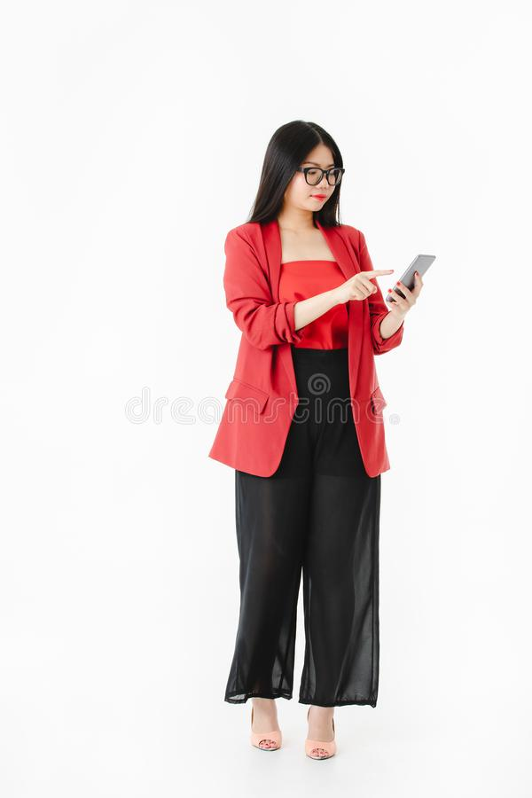 Asian woman in casual dress hold smartphone in her hand royalty free stock image