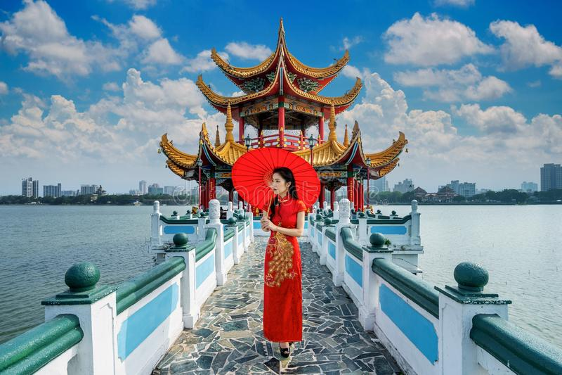 Asian woman in chinese dress traditional walking at Kaohsiung`s famous tourist attractions in Taiwan. Asian woman in chinese dress traditional walking at royalty free stock photos