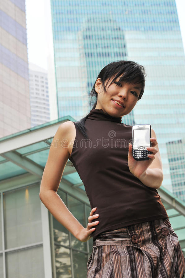 Asian Woman In The City twittering stock photography