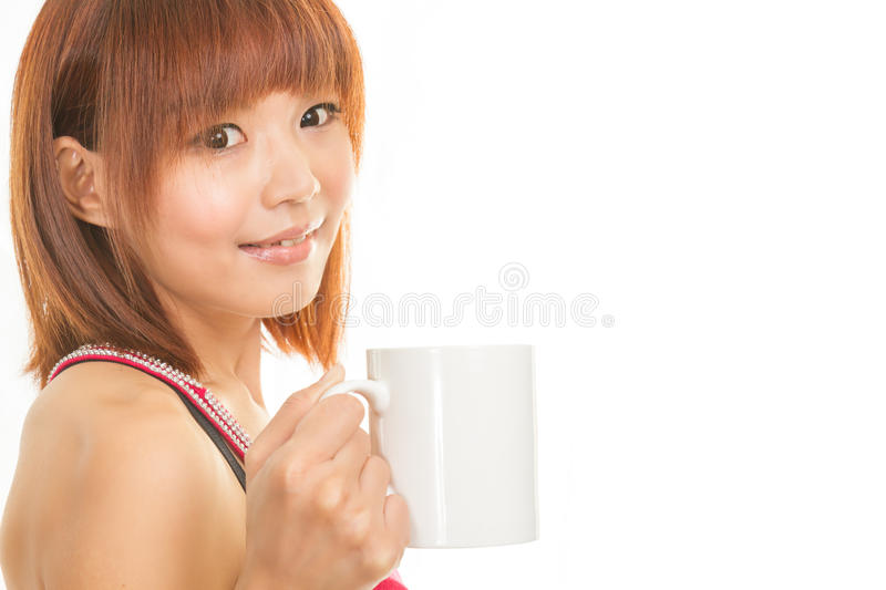 Asian woman with coffee cup stock photography