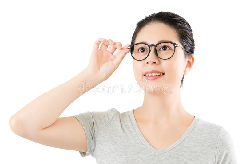 Asian woman content natural looking over her classy glasses royalty free stock image