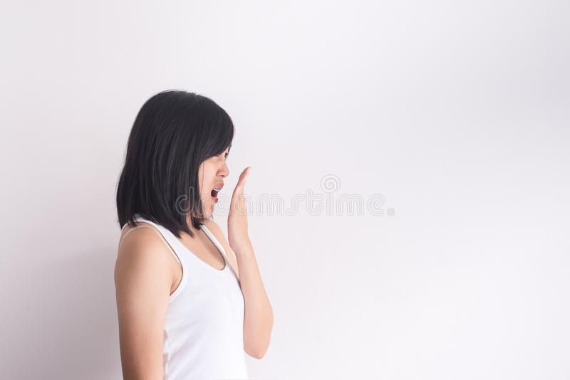 Asian woman covering her mouth and smell her breath with hand after wake up,Bad smell. Asian woman covering her mouth and smell her breath with hands after wake stock images