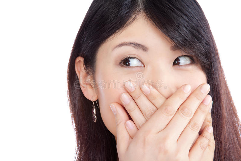 Asian Woman Covering her Mouth royalty free stock photos