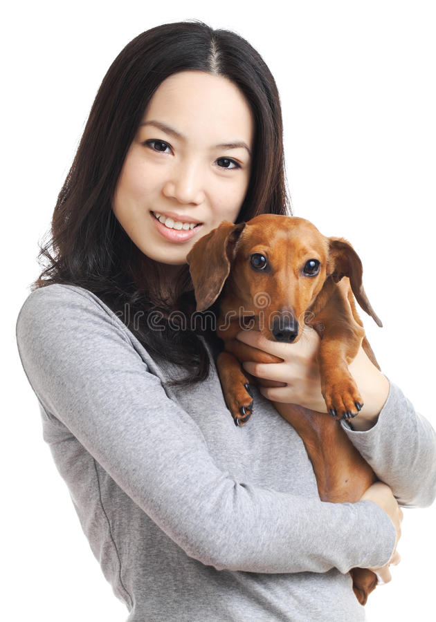 Asian woman with dachshund dog. Isolated on white background stock images