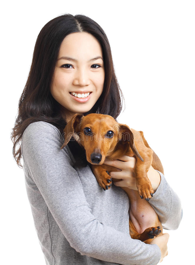 Asian woman with dachshund dog. Isolated on white background royalty free stock photography