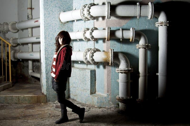 Asian woman in dark area showing sad mood royalty free stock photos