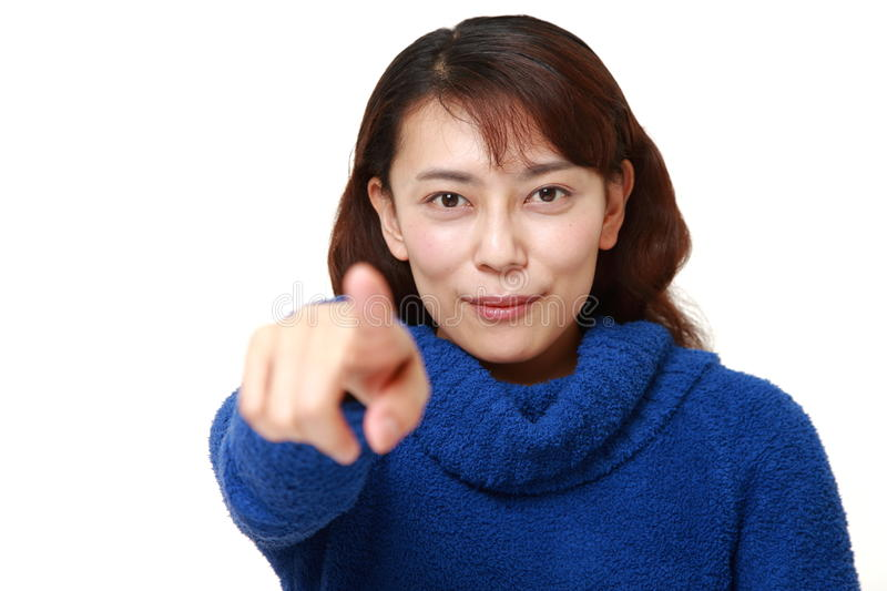 Asian woman decided. Studio shot of young asian woman on white background stock photo
