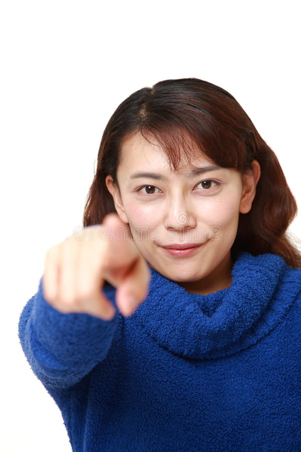 Asian woman decided. Studio shot of young asian woman on white background stock images
