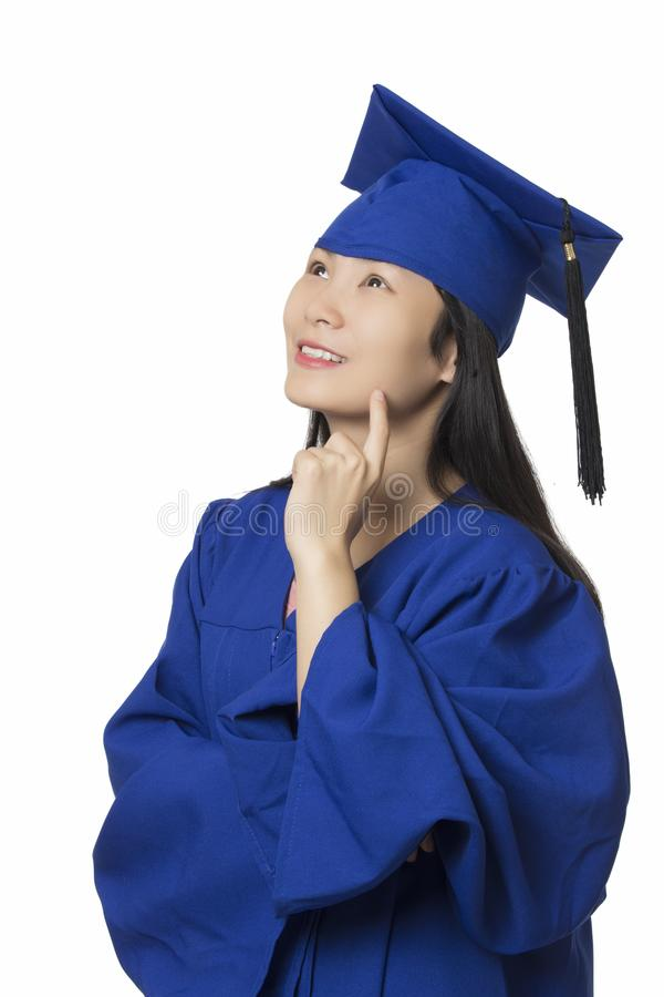 Asian Woman Deep In Thought Wearing Graduation Gown Isolated Whi ...