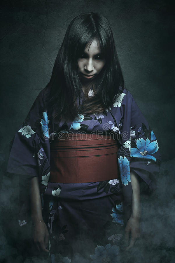 Asian woman with demon eyes. Scary japanese ghost with demon eyes . Horror and halloween royalty free stock images