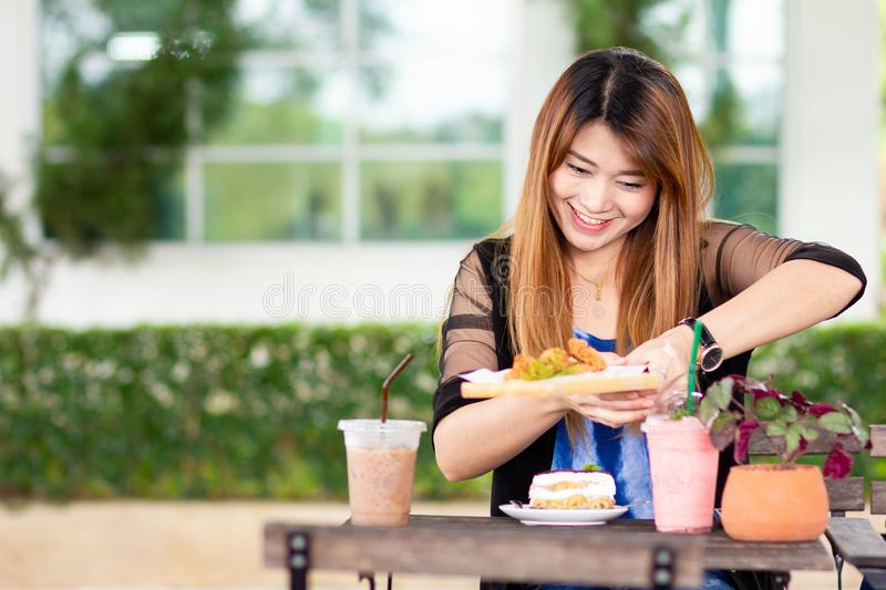 Asian woman with desserts stock image