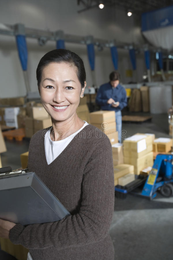 Asian Woman In Distribution Warehouse stock photo