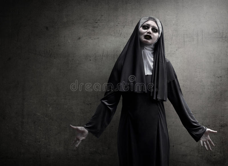 Asian woman dressed in evil nun royalty free stock photography