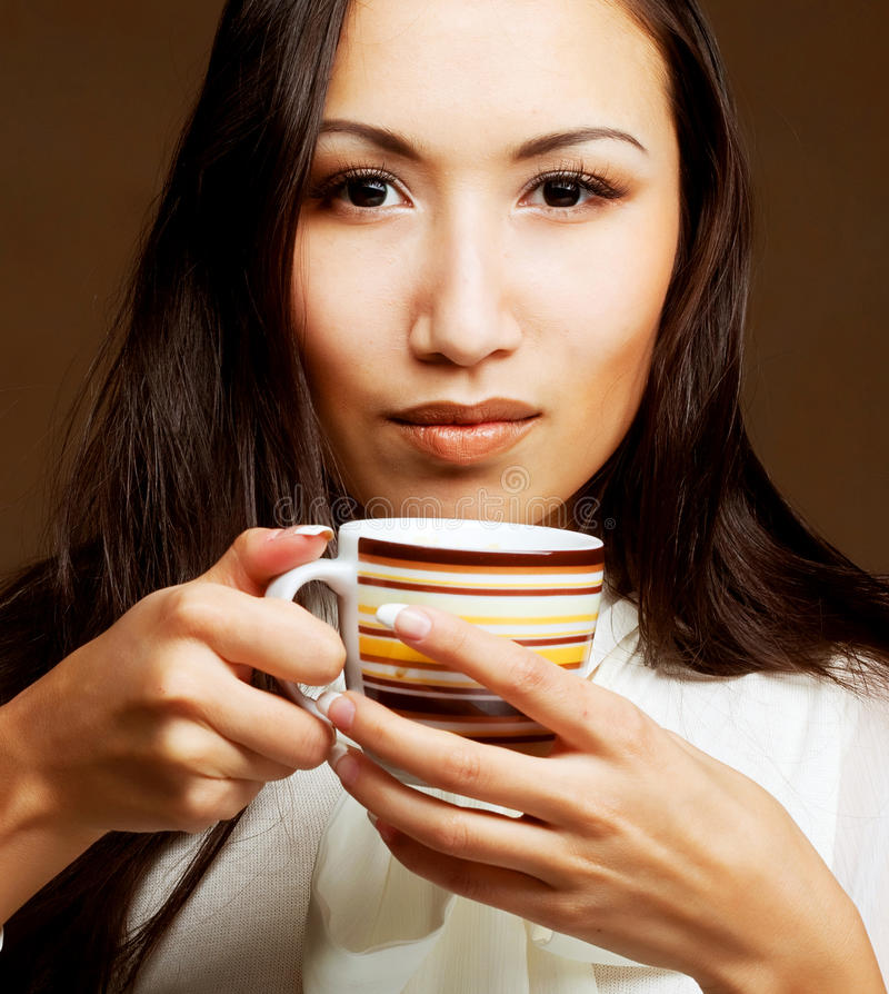 Asian woman drinking coffee or tea royalty free stock images