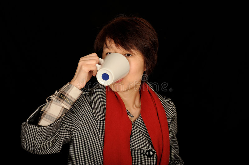 Asian Woman Drinking From Cup Royalty Free Stock Image