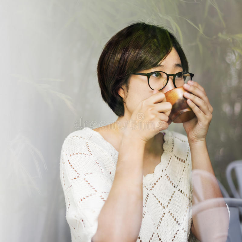 Asian Woman Drinking Tea Relax Concept stock photography